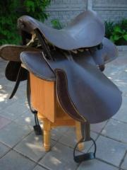 Saddle for a horse, leather (with stirrups + a