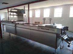 Automatic Multivac R 145 vacuum transfer line
