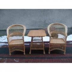 Set of a wicker furniture two chairs and little