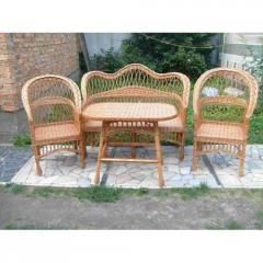 Set of a wicker furniture sofa, little table,