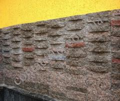 Finishing by a natural stone of a facade of the