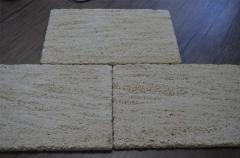 Tile from a natural stone of travertine