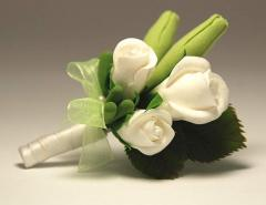 Buttonhole from white roses. Handwork. Flowers are