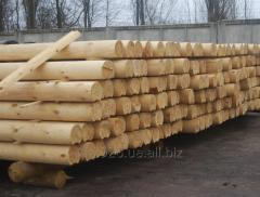 The rounded logs for construction of houses and