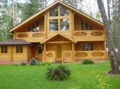 Cottages wooden of the rounded log from the