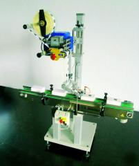 System for upper gluing of labels of Etipack