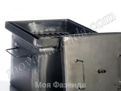 The smoking shed on wood spill for fish Ukraine