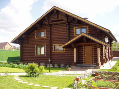 Inexpensive country houses from the cylindered log