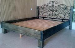 Bed wooden with a shod back
