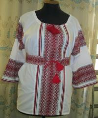 Blouse female with finishing by ornament, with bel