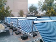 Всесезонный солнечный коллектор с вакуумными