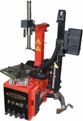 The machine for mounting and dismantle of tires and cameras of cars the automatic machine