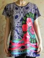 Tunic with a print of a rose and N3884 pastes