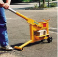 The universal car for the mechanized laying of paving slabs