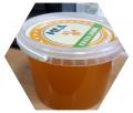 La miel pura, natural de 1,2 kg De flores.