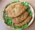 Пирожки с рисом, яйцом и луком жареные  (замороженные)