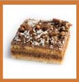 Пирожное бисквитное Тропиканка, крем из вареной сгущенки, черный шоколад, кокосовая стружка