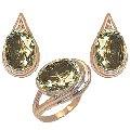 Гарнитур «Болеро» Артикул: 11085, кольцо 9,50 гр + серьги 13,00 гр, желтое золото 585  пробы с драгоценными, полудрагоценными камнями  прозрачные камни крупные -цитрин