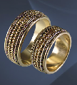 Wedding rings Au 585 gold ° tests, weight - 7,95gr, the main detail with sides is made of gold of yellow (European) color, the central part consists of a set of springs - white color more filigree - yellow color, the article G 1036