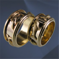 Wedding rings yellow Au 585 gold ° luxury tests, weight - 10,0 gr, the article of the M 1185. Consists of twelve details. The rotating central part consists of 4 figures of dolphins of yellow color, napayeny on a ring of white color