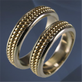 Wedding rings Au 585 gold ° tests, weight - 5,5 gr, the article G 1705. The boards - white polished, filligran - yellow polished