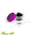 Black eyelashes in small jars