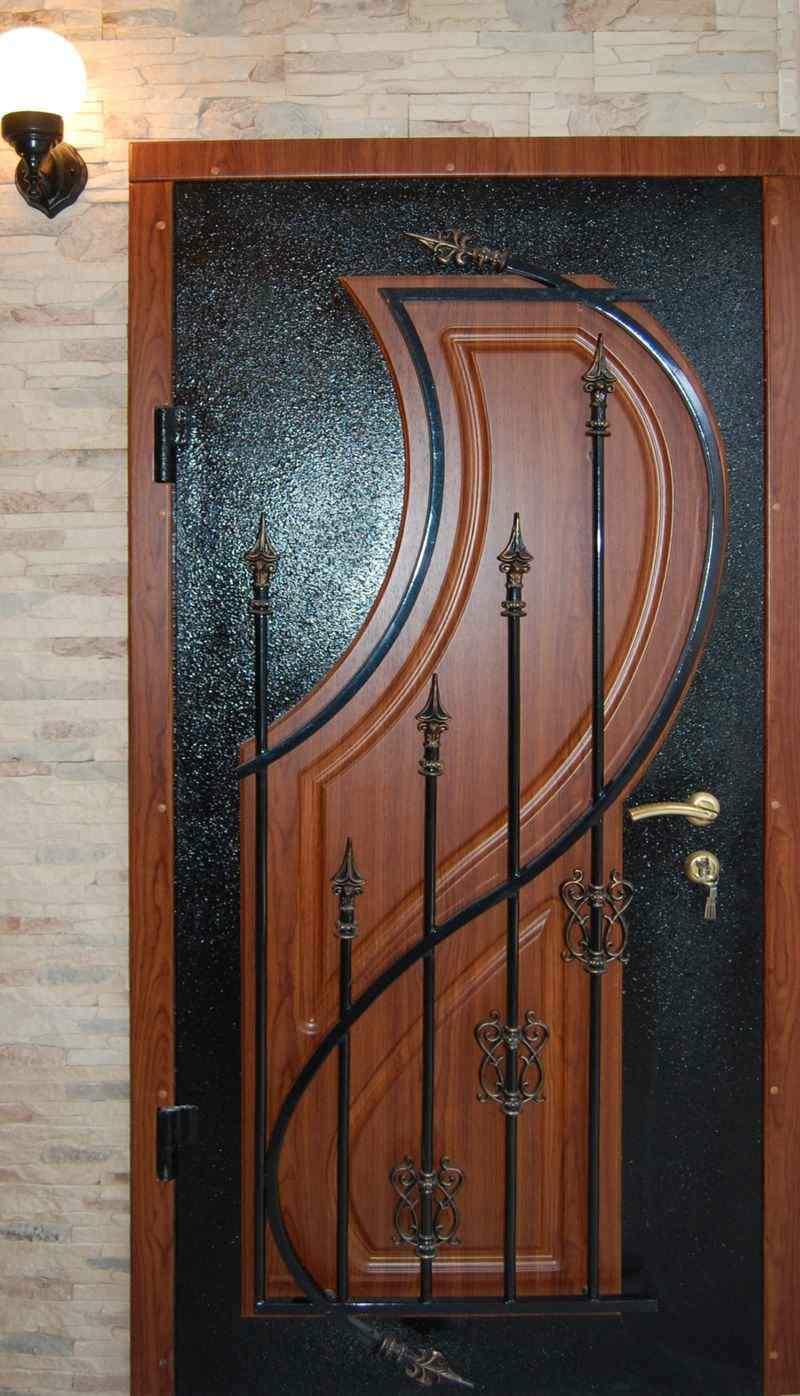 недорогие металлические двери с ковкой шумо и теплоизоляционные