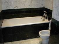Заказать Облицовка стен и пола ванных комнат и душевых кабин гранитом