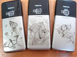 Нанесение изображений на мобильные телефоны, лазерная гравировка, Днепропетровск