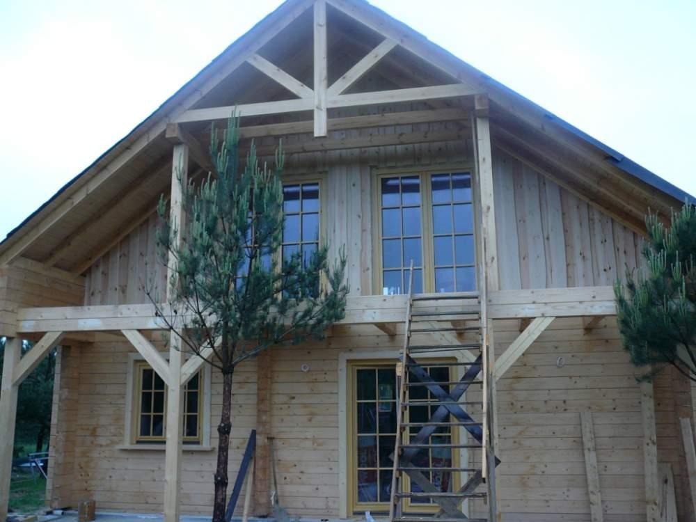 Заказать Строительство домов из дерева из прямоугольного бруса