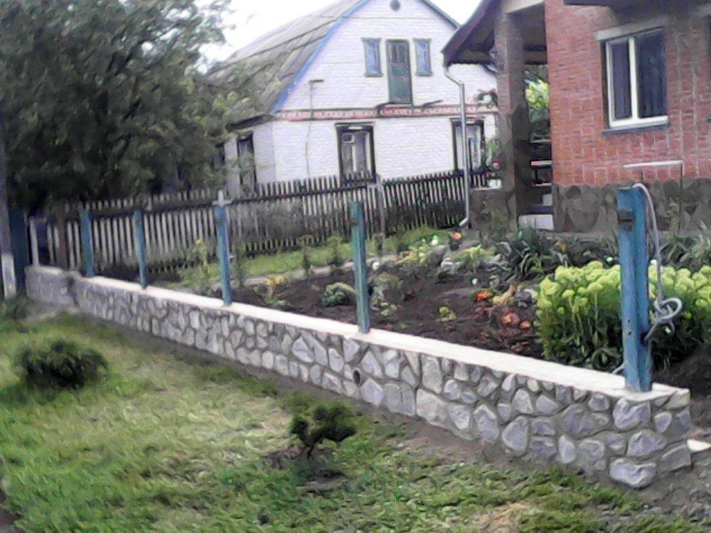 Строительство заборов с камня.