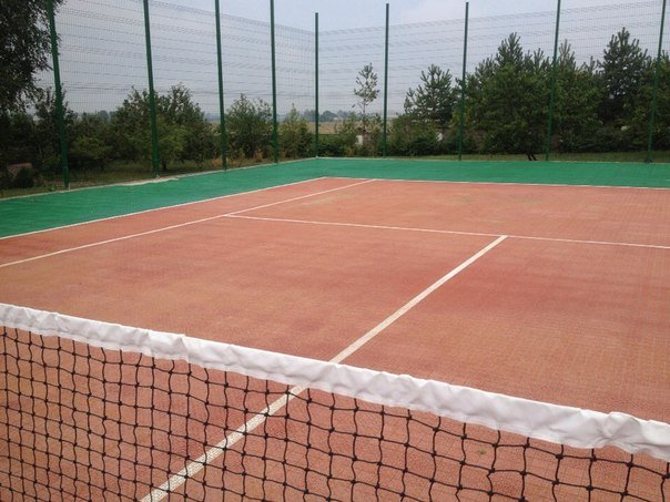 Заказать Укладка покрытия ГЕОДОР для теннисного корта. Укладка покриття ГЕОДОР для тенісного корту.