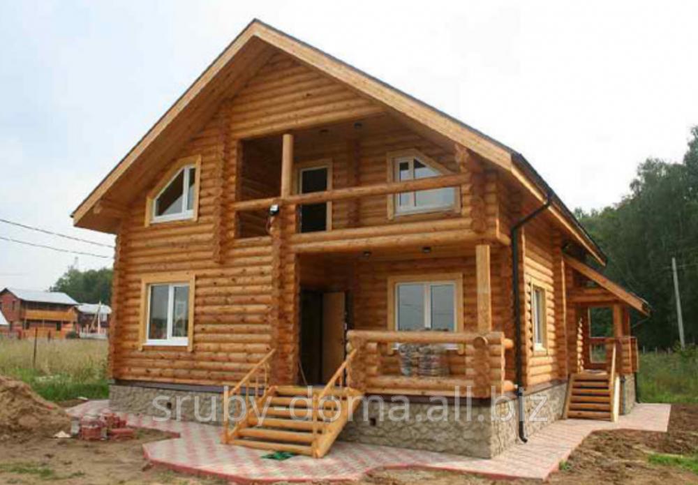 Заказать Строительство канадских домов из карпатского дикого сруба в Украине. Акция - 1350 грн. за м² по стене.