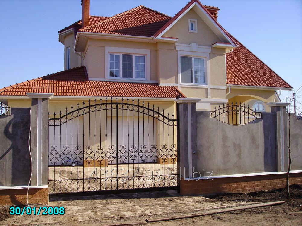 Заказать Изготовление и установка металлического кованного забора с воротами под ключ