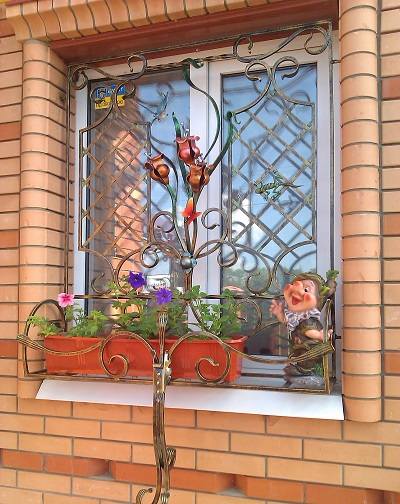 Заказать Изготовление кованых решеток на окна под заказ