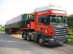 Road haulage of bulky goods, industrial equipment,