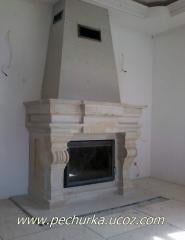 The fireplace revetted with an artificial stone