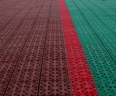 Laying of sports coverings for tennis courts