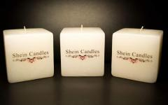 Candles with drawing the image (a logo, the photo,