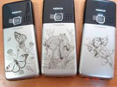 Drawing images on mobile phones, a laser engraving, Dnipropetrovsk