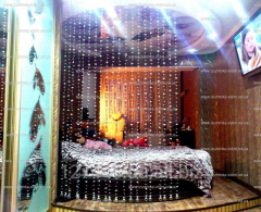 Design in an interior. Curtains from beads.