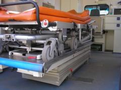 To transport the patient with a head injury,