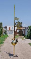 Weather vane from stainless steel of golden color
