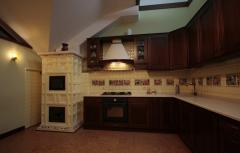 He tiled furnace with oven + facing of kitchen