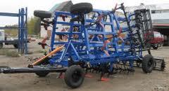 Re-equipment of hinged harrows in hook-on.