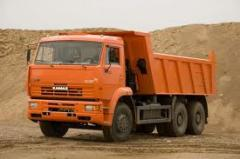 Transportations by dump trucks, Ukraine. Rolling