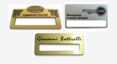 Production of badges from plastic and metal.