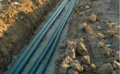 Laying of cables in earth trenches Kiev.