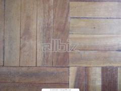 Laying of a board of a floor, parquet board