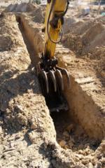 Рытьё траншей с укладкой трубопровода